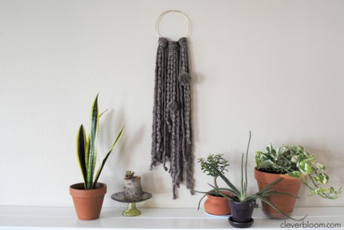 This Ring Wall Hanging is an inexpensive and simple way to add a little bohemian style into your home.